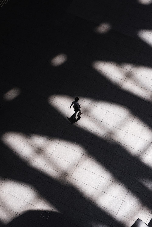 woman walking on white tiled flooring
