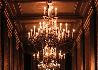 lightened chandelier inside the hall
