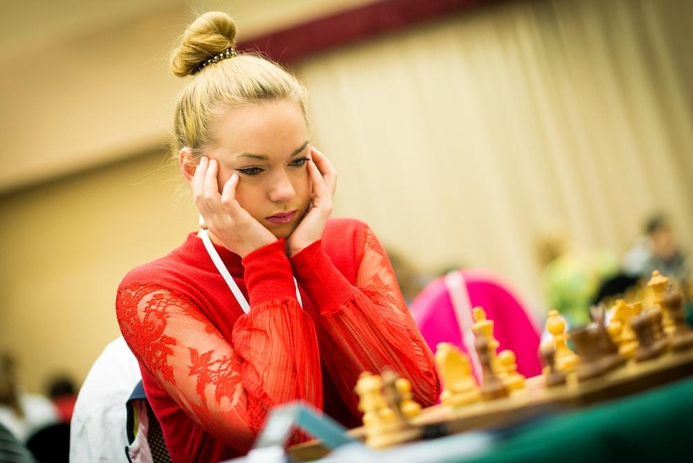 woman playing chess