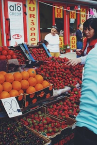 woman buying strawberries at the market