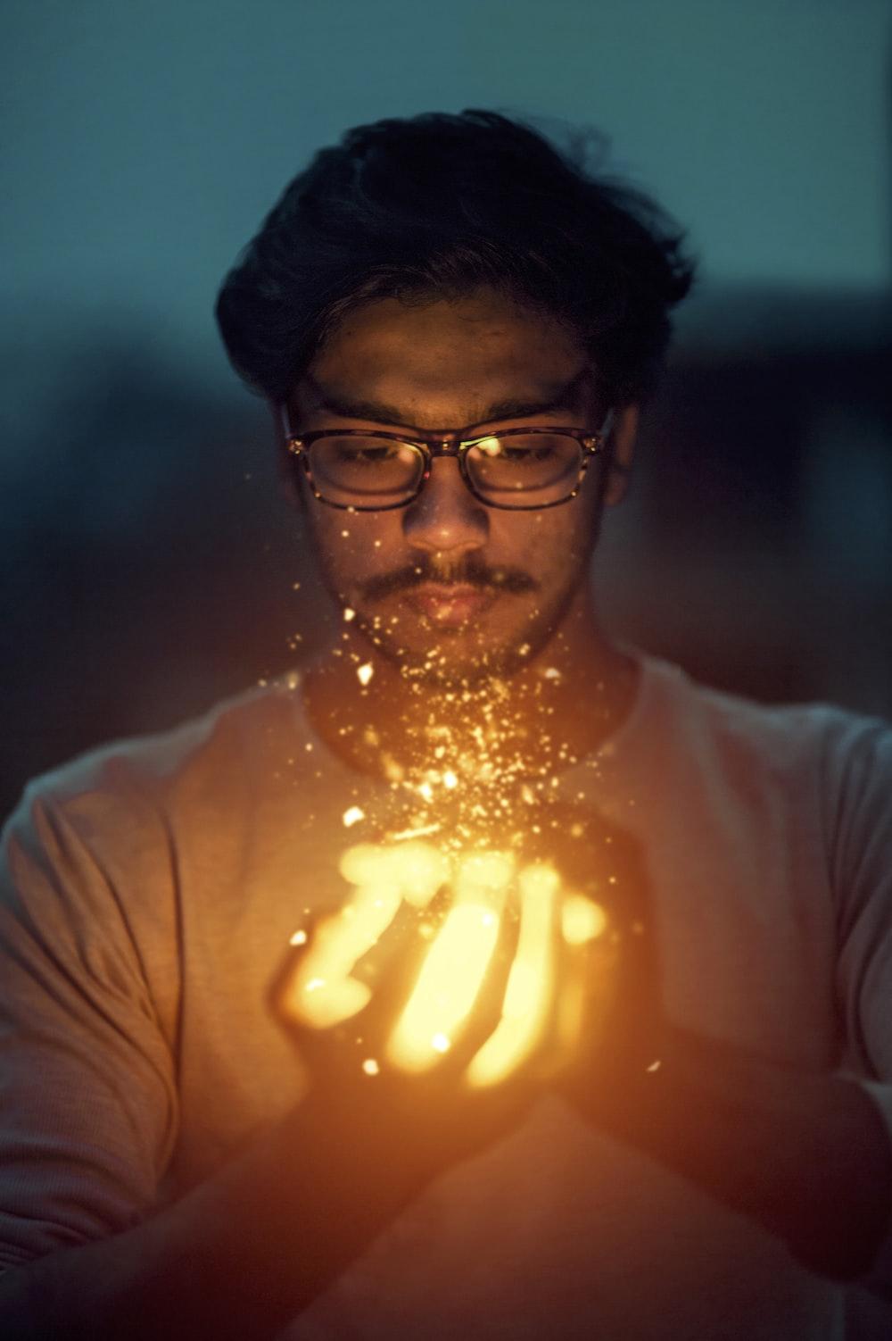 man holding lighted art