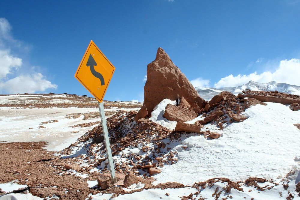 signage near rock formation and snow