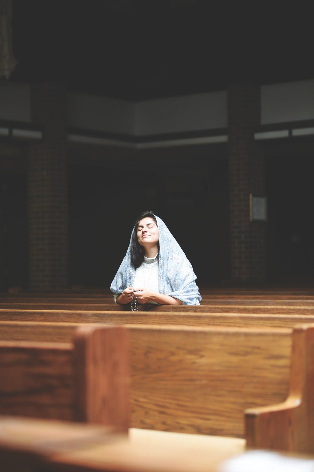 woman holding rosary
