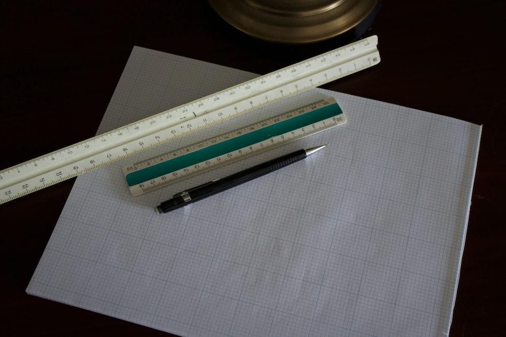 white ruler on paper