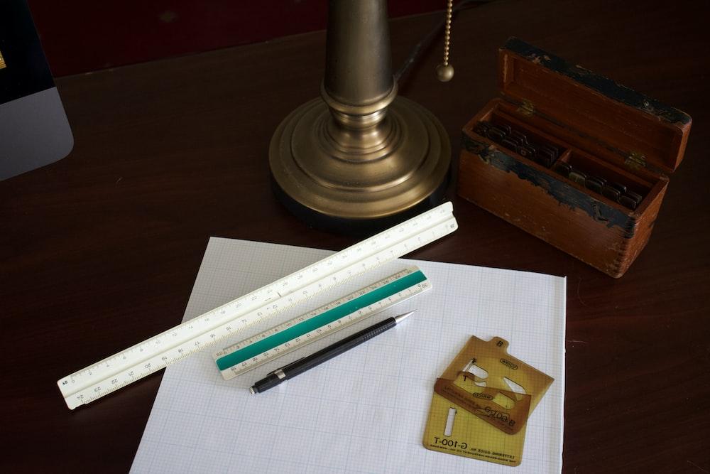 white ruler on white paper