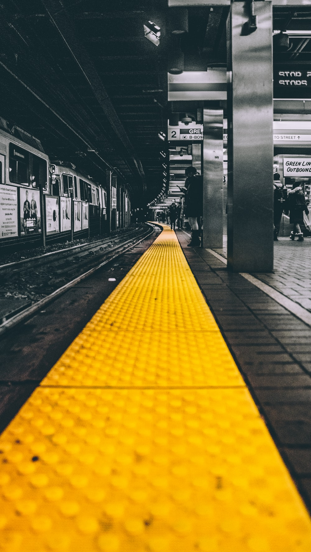 selective color photo of train station