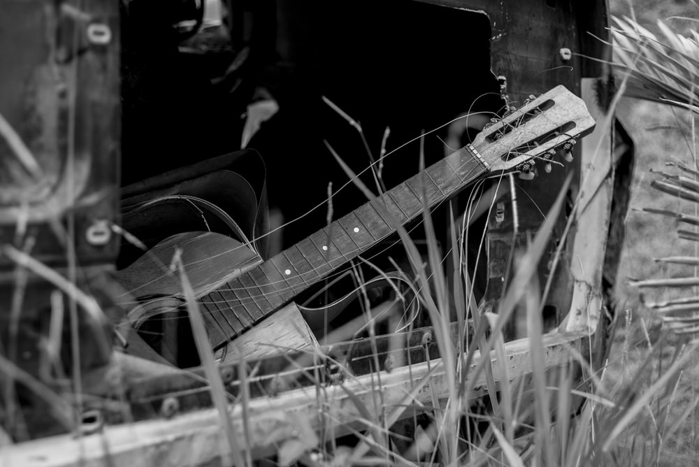 grayscale photo of guitar