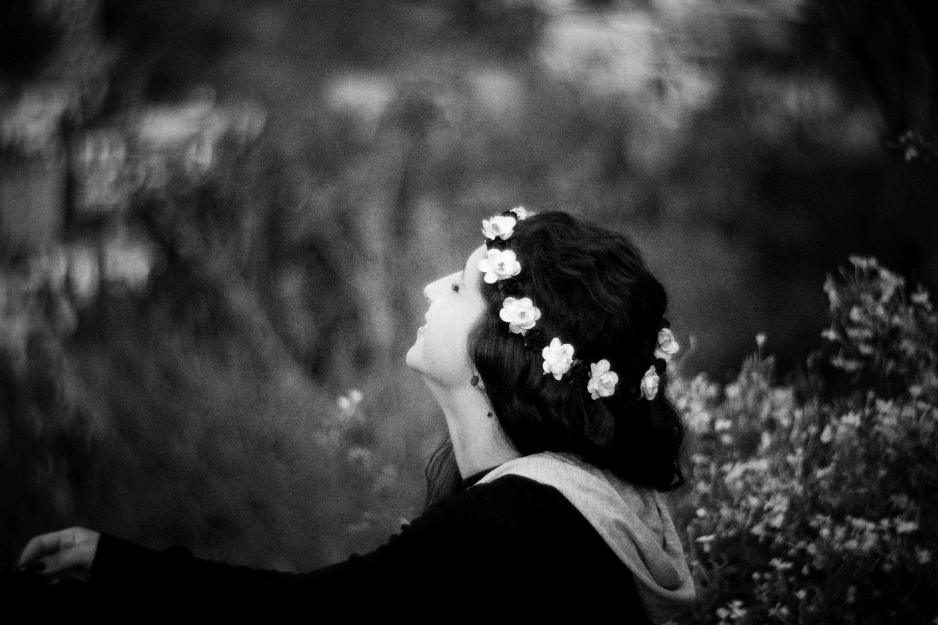 grayscale photograph of woman in garden