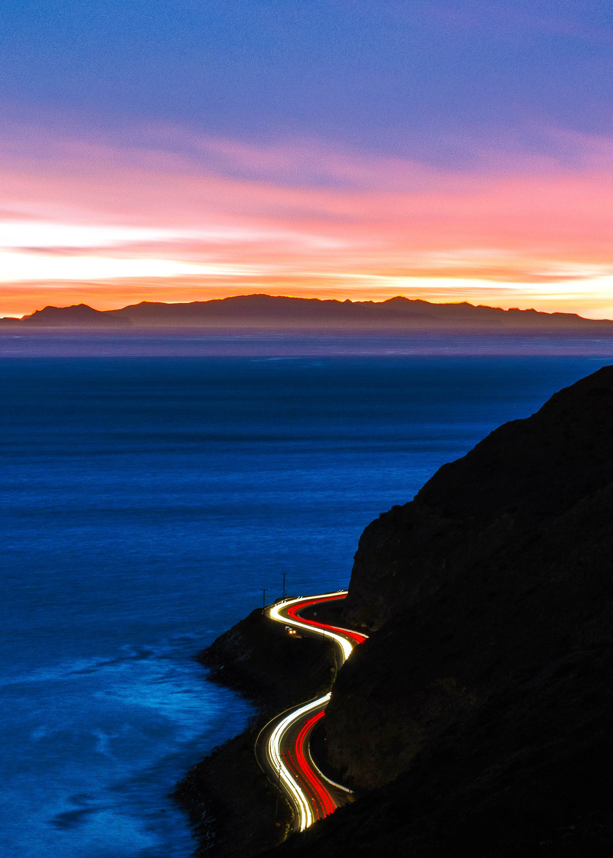 time-lapse photography of cliff road during golden hour