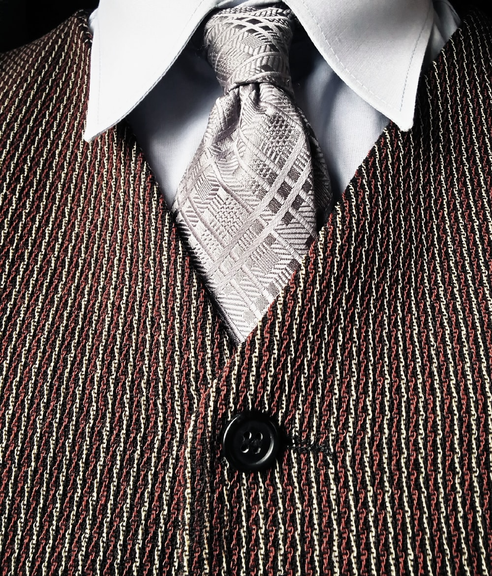 gray necktie and brown button-up vest