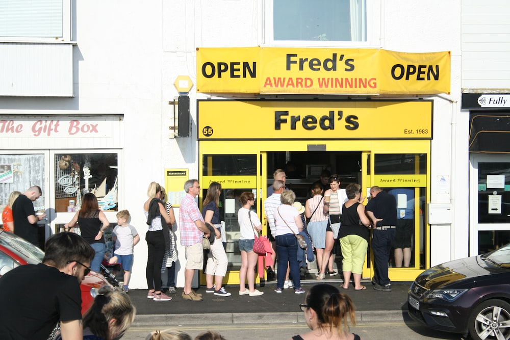people falling in line in front of Fred's store