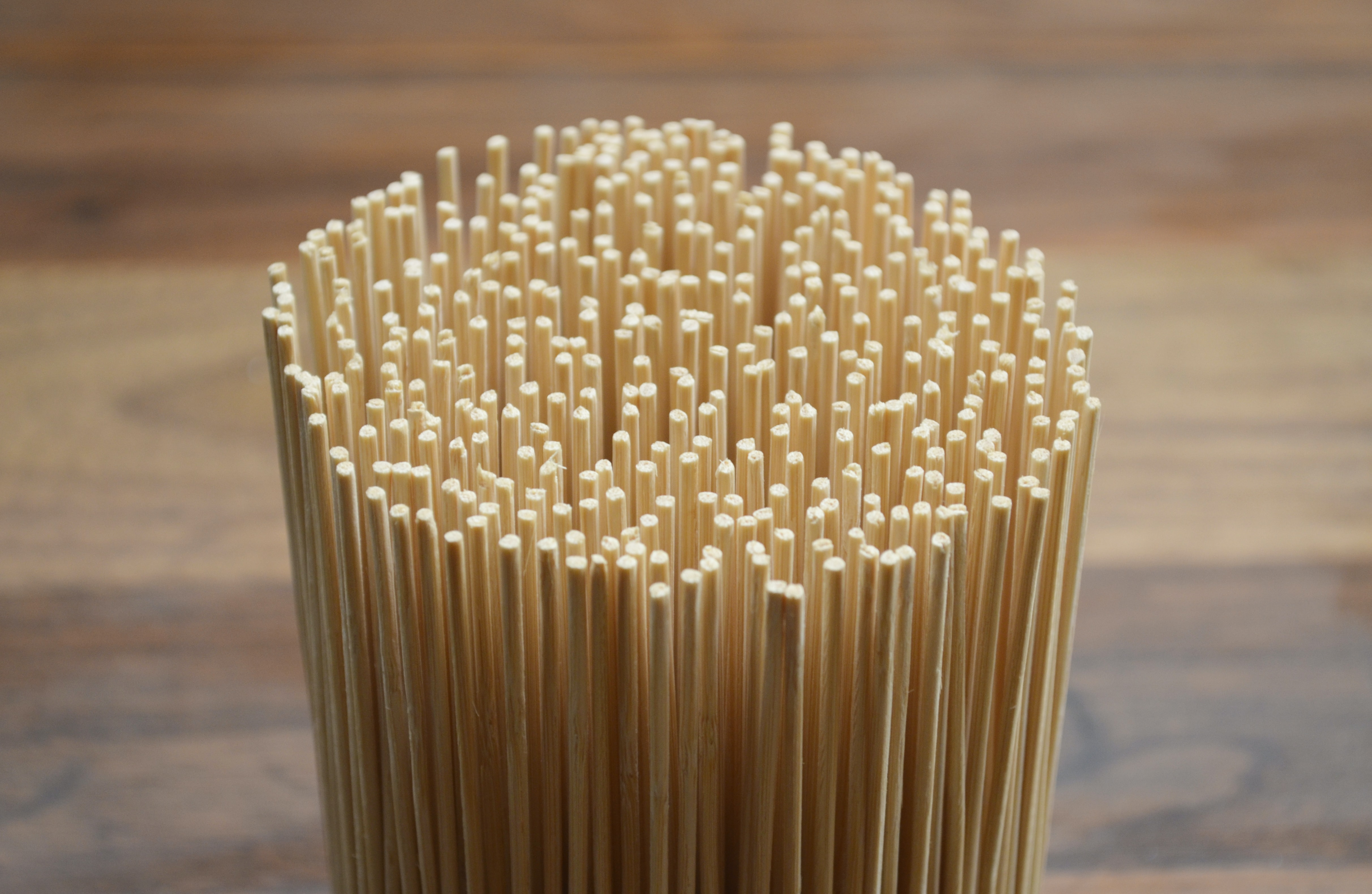 stack of uncooked pasta near wood