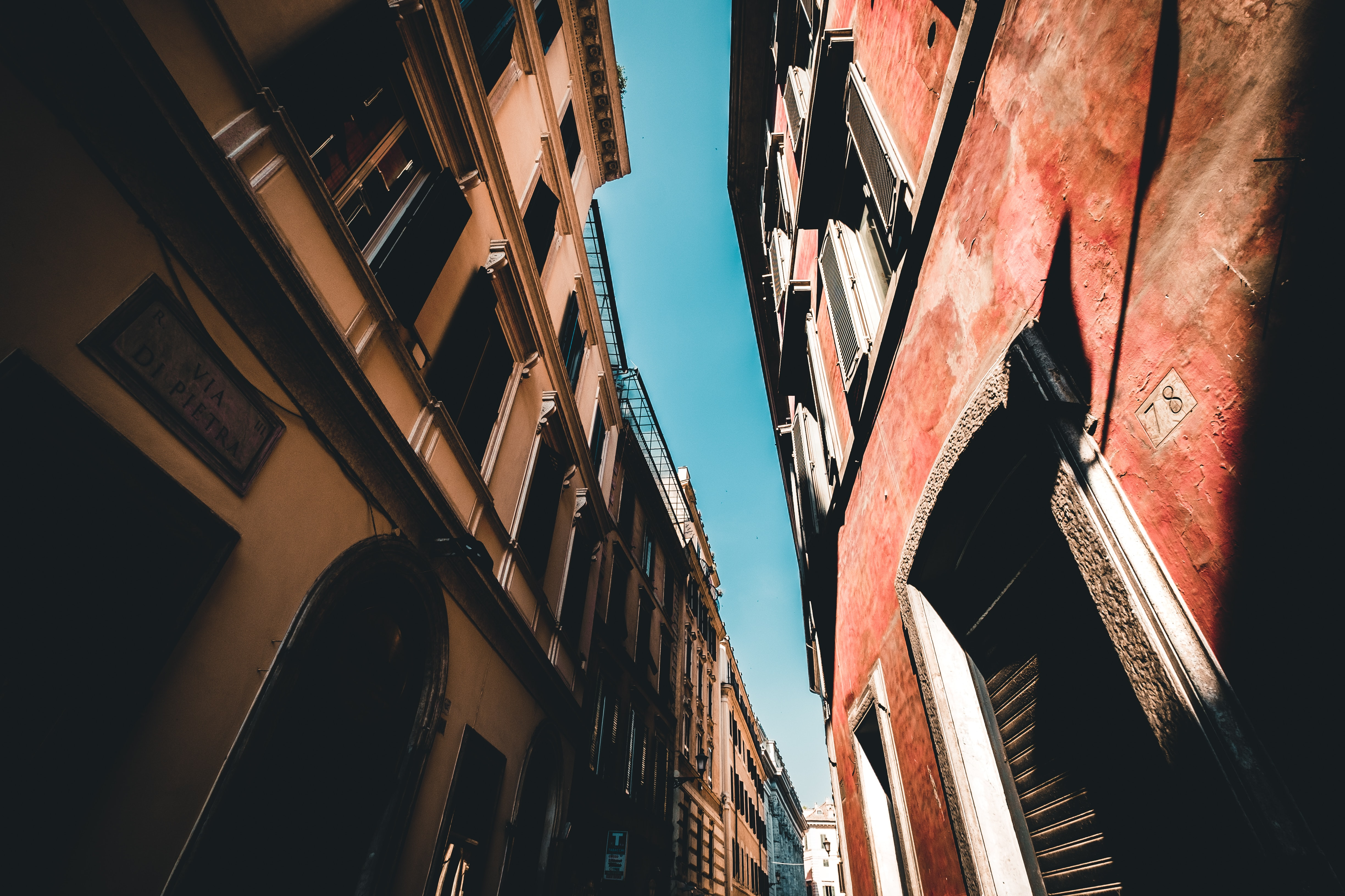 low angle photography of two buildings