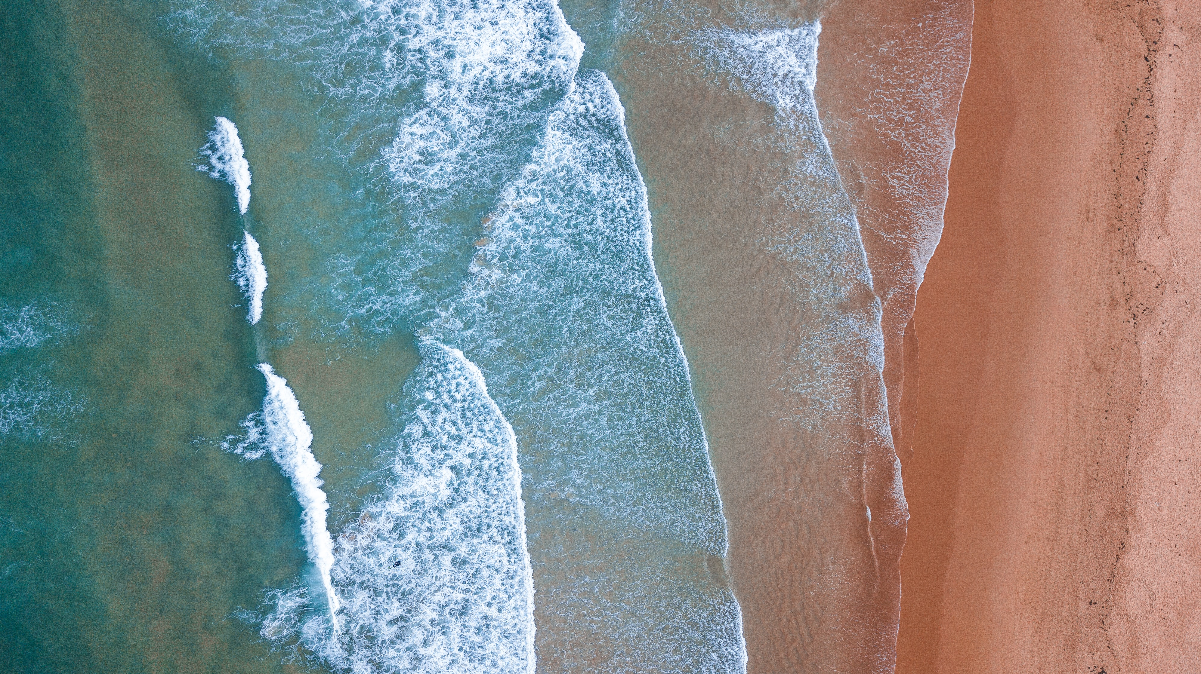 aerial photography of sea wave in shoreline