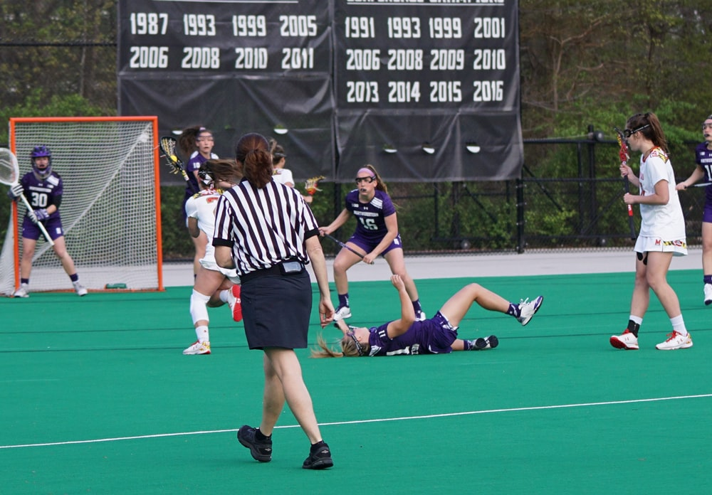 group of woman playing lacrosse