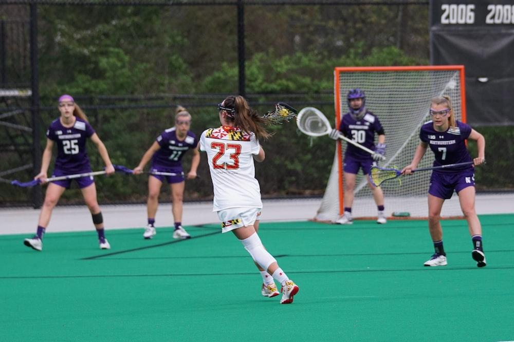 girls playing lacrosse game