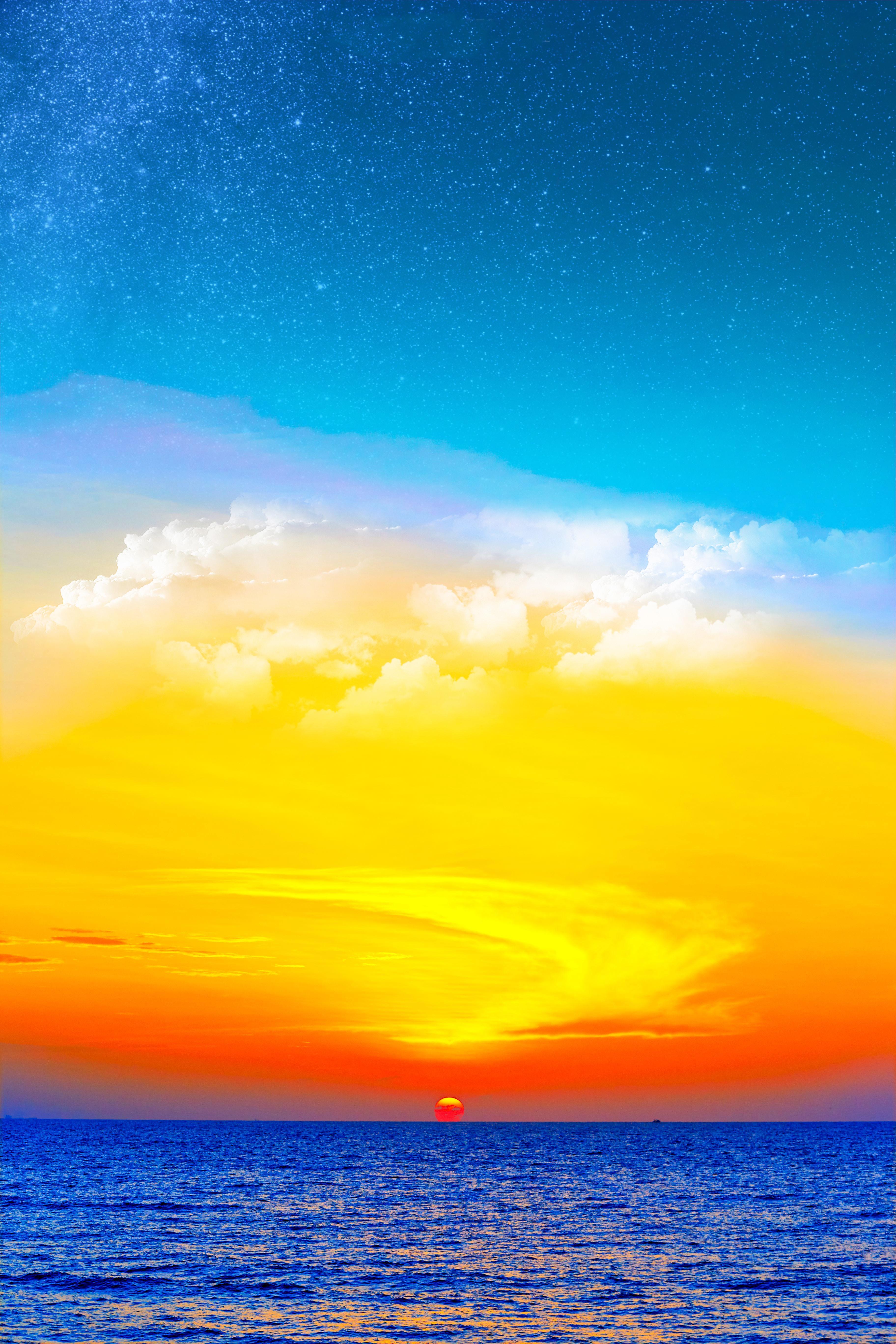 blue sea under blue, white, and orange sky during sunset digital wallpaper