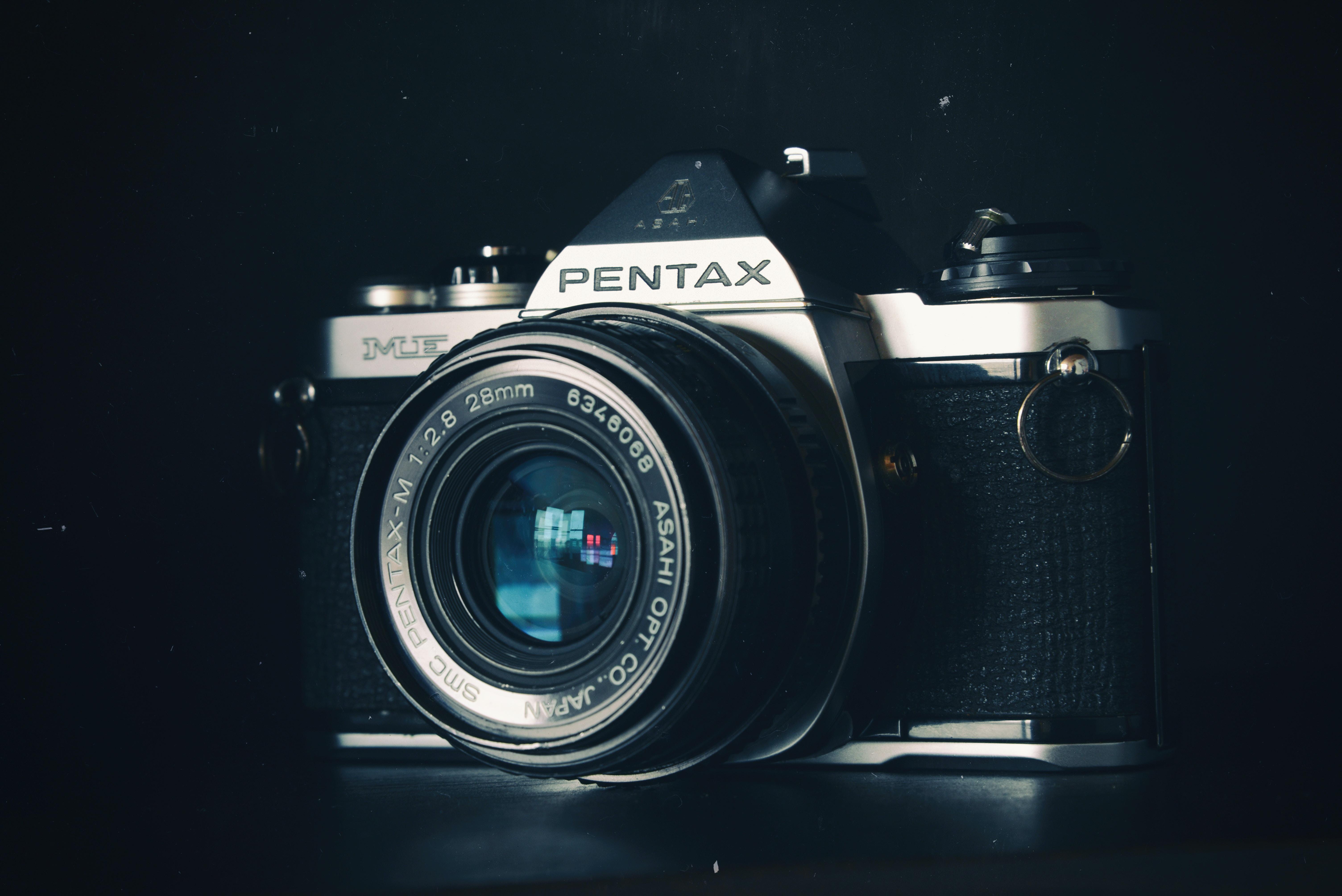 gray and black Pentax SLR camera