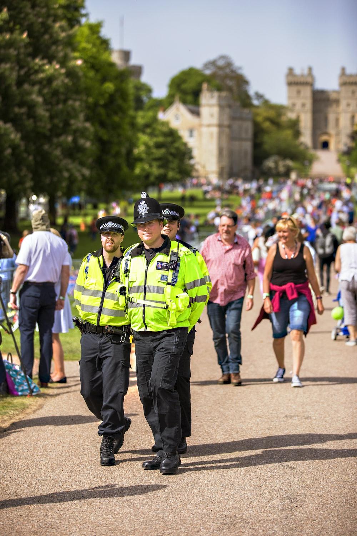 three policemen patrolling on the street