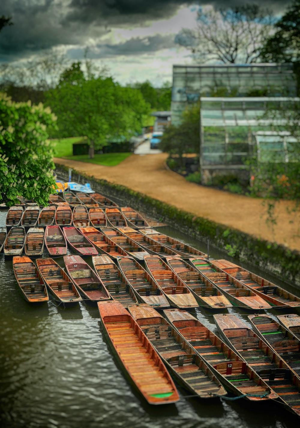 brown wooden canoe near building