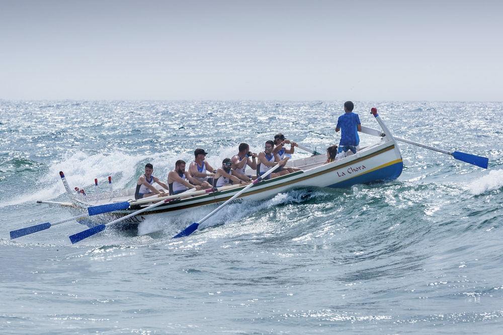 group of men riding boat