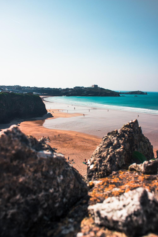 beach beside rock formation