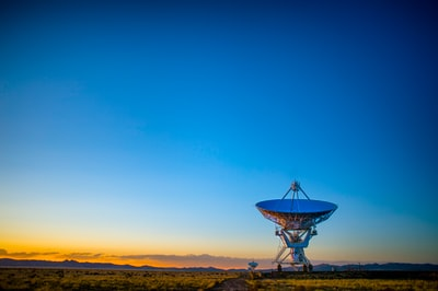 I was up early on a very cold morning in New Mexico to ride my motorcycle back toward home (Phoenix). The sun started coming up so I stopped to get some warmth and was captivated by these eerie looking radio telescopes. The dawn light gave me just the feeling I was experiencing at the time. I spent about an hour there making images in that soft side light. Warmer, I hopped on the cruiser and headed out. It was still cold though… dang.