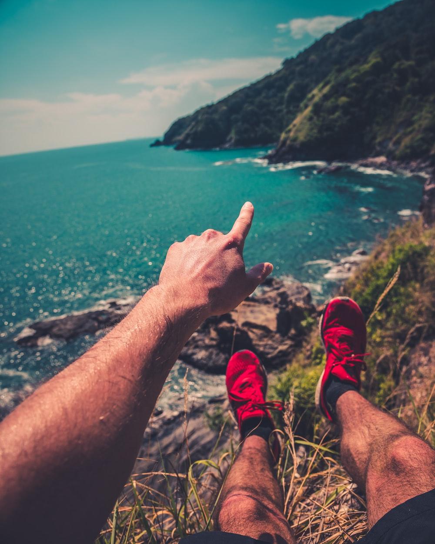 man pointing the mountain