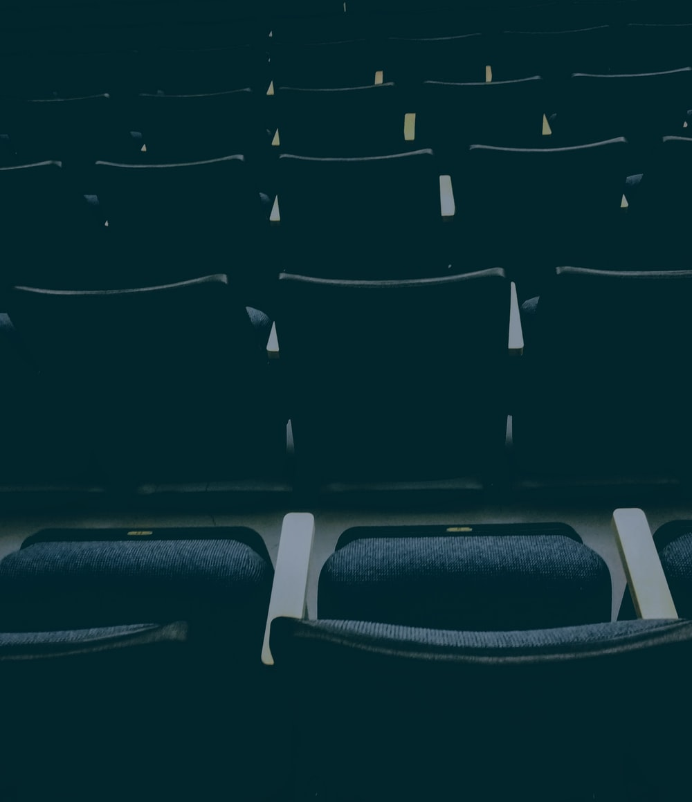 unfolded empty theater chairs