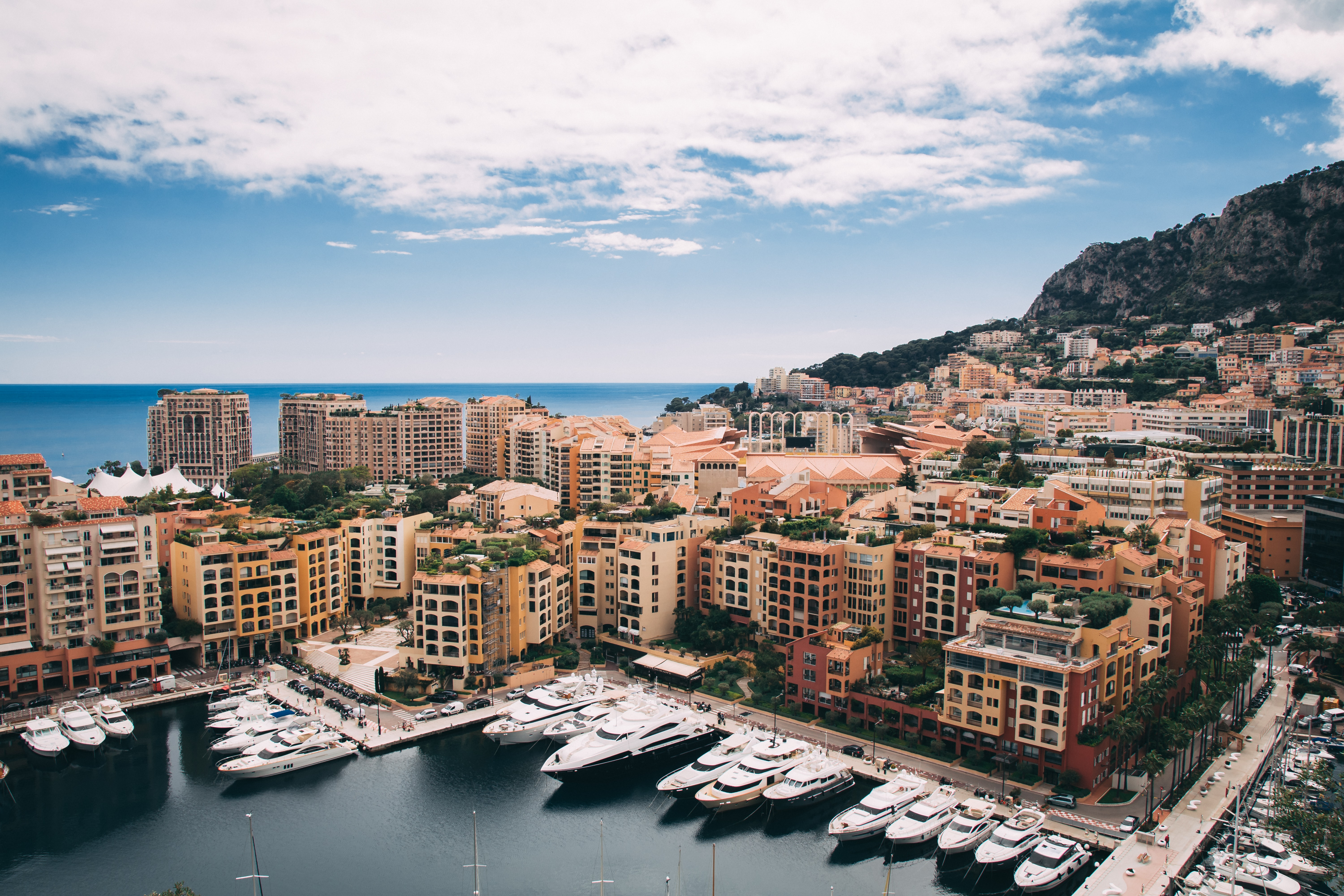 aerial photography of docks yachts near buildings