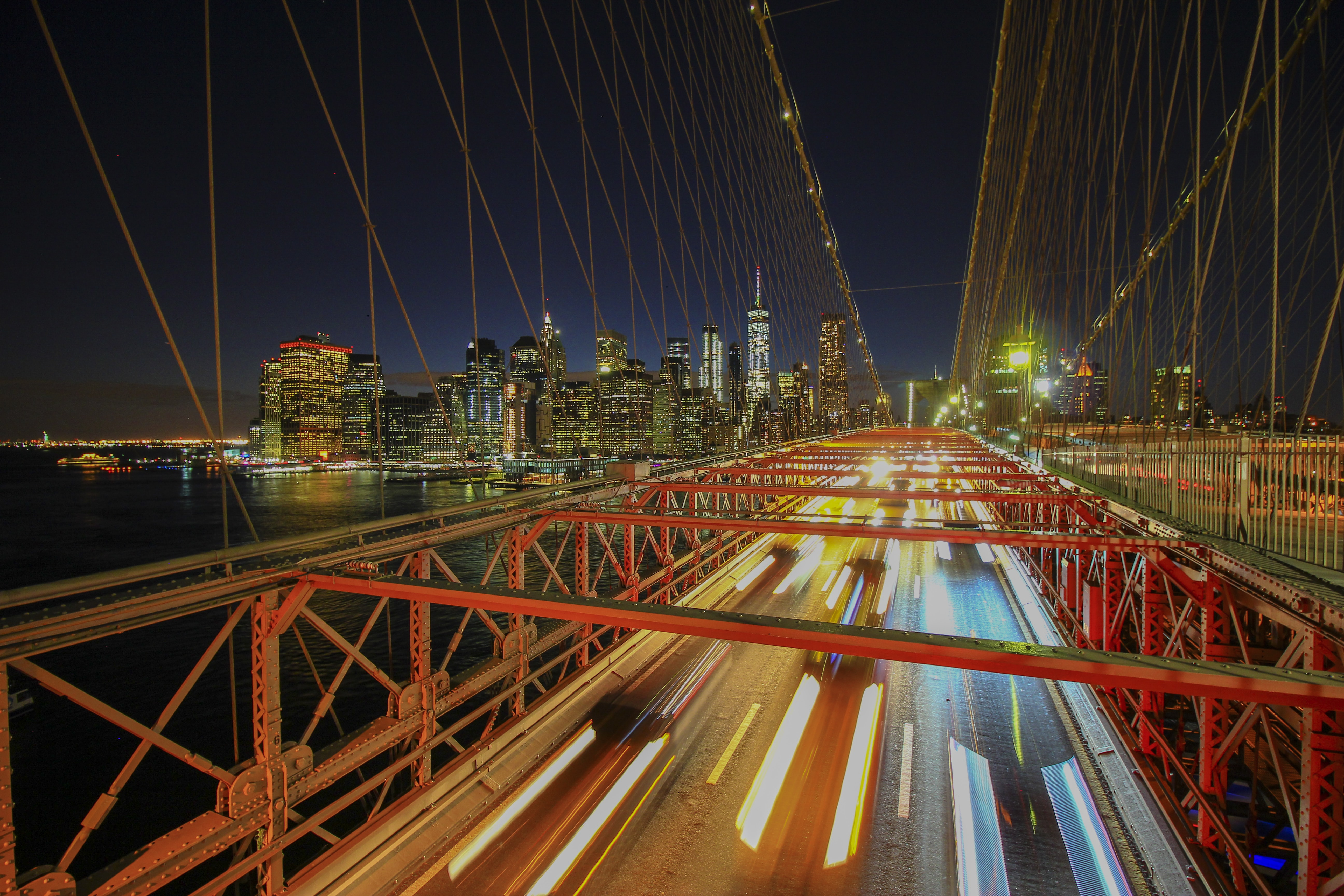 time-lapse photography of vehicles on the bridge during day