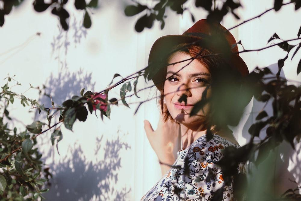 woman posing near trees