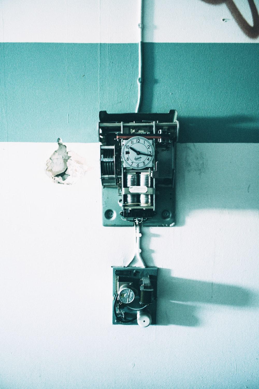 black and gray wall analog clock hang on wall