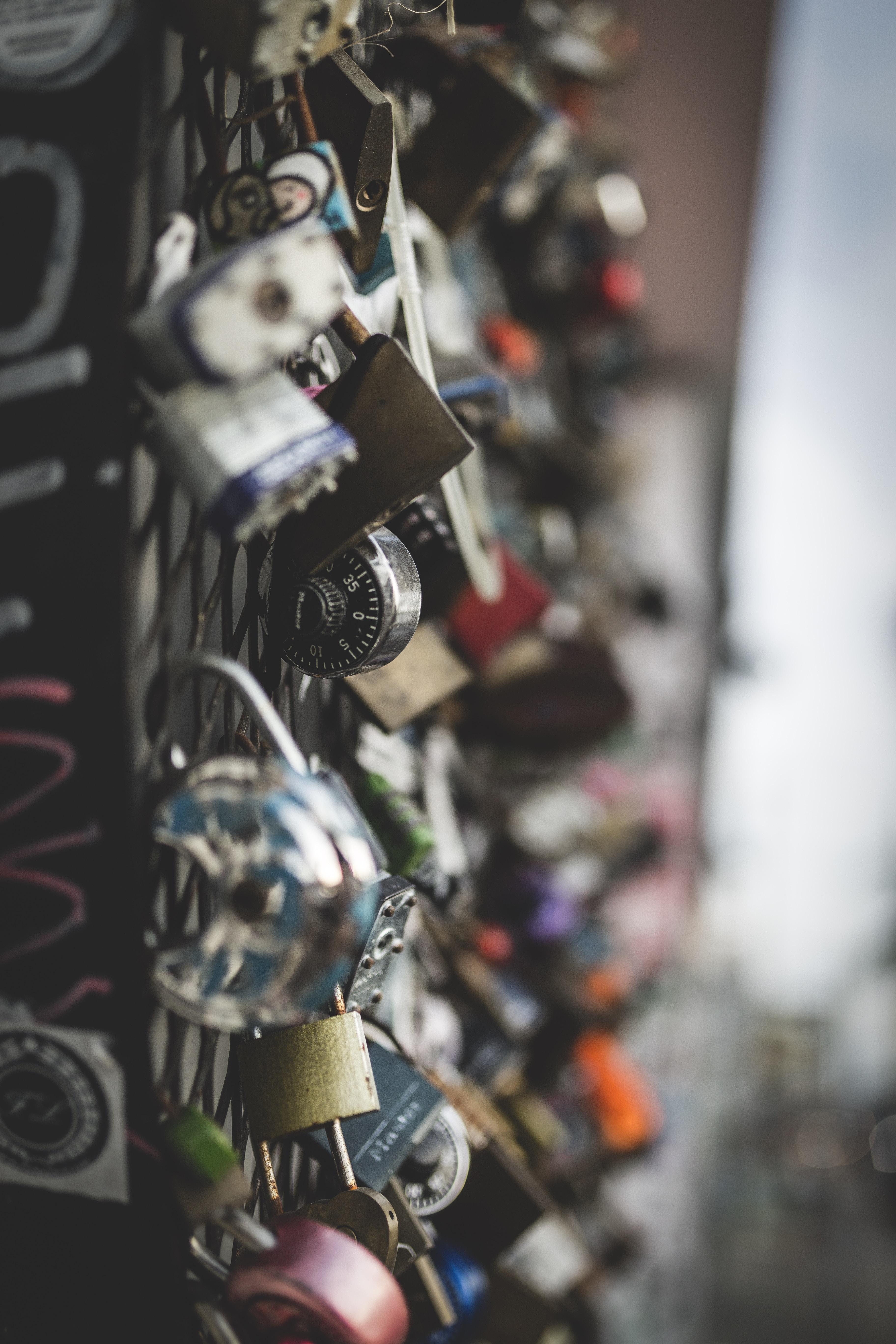 closeup photography of metal padlocks