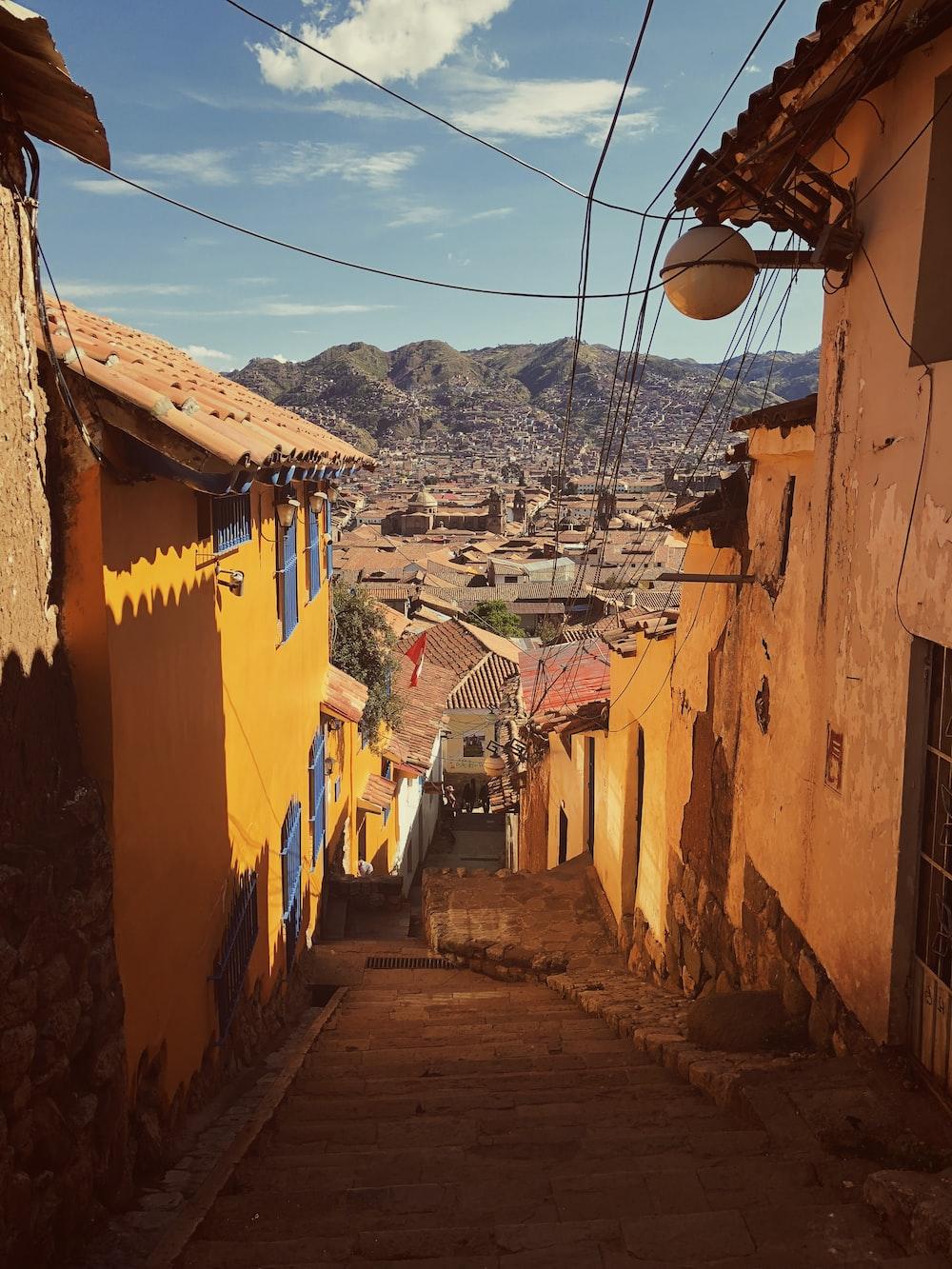 orange houses near green mountain