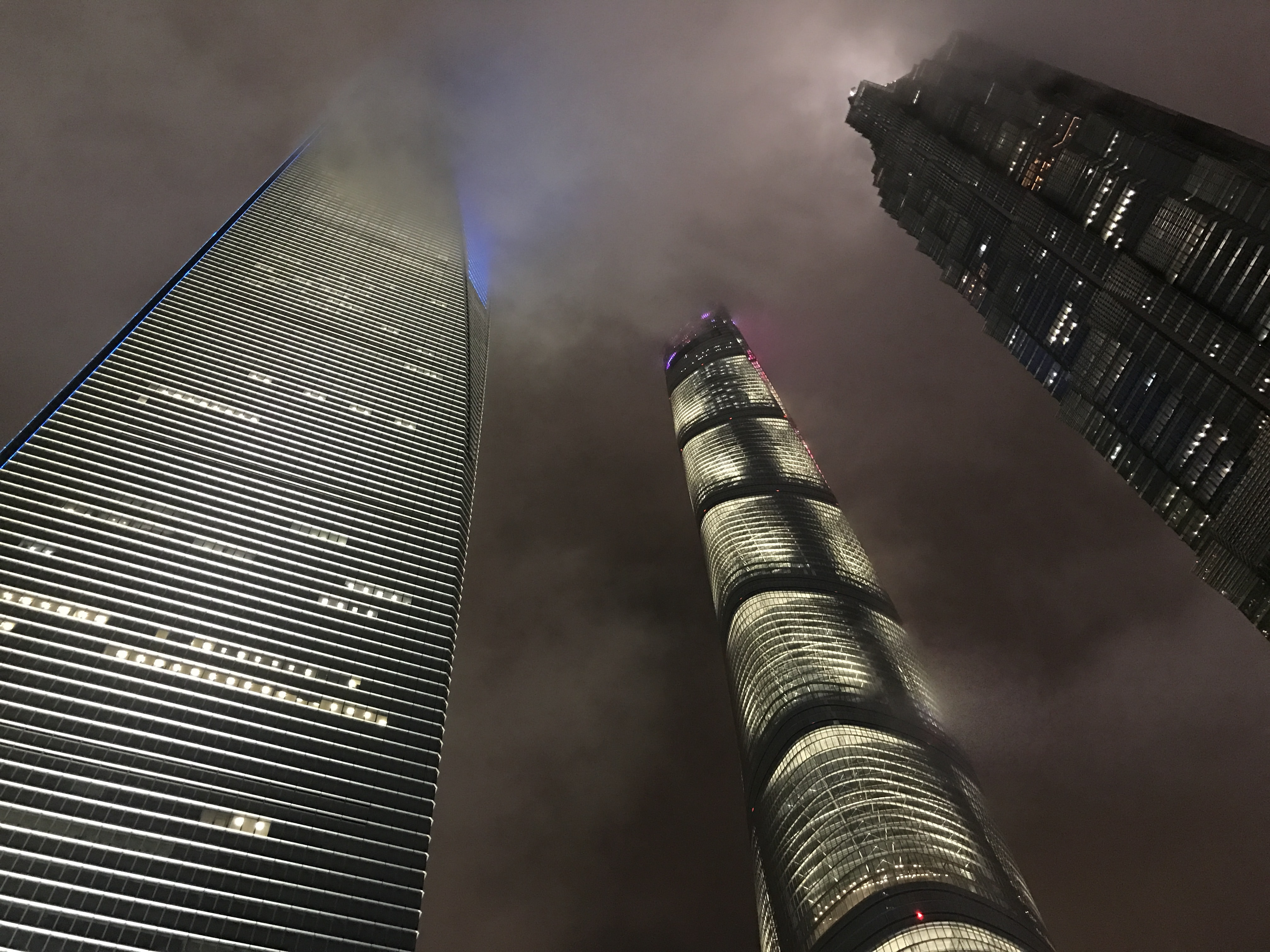 low angle photography of three high rise buildings