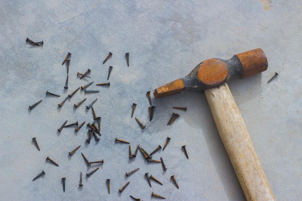 flat-lay photograph of hammer and nails