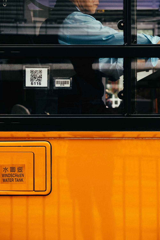 man inside orange bus
