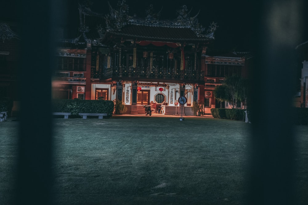 lighted brown temple at nighttime