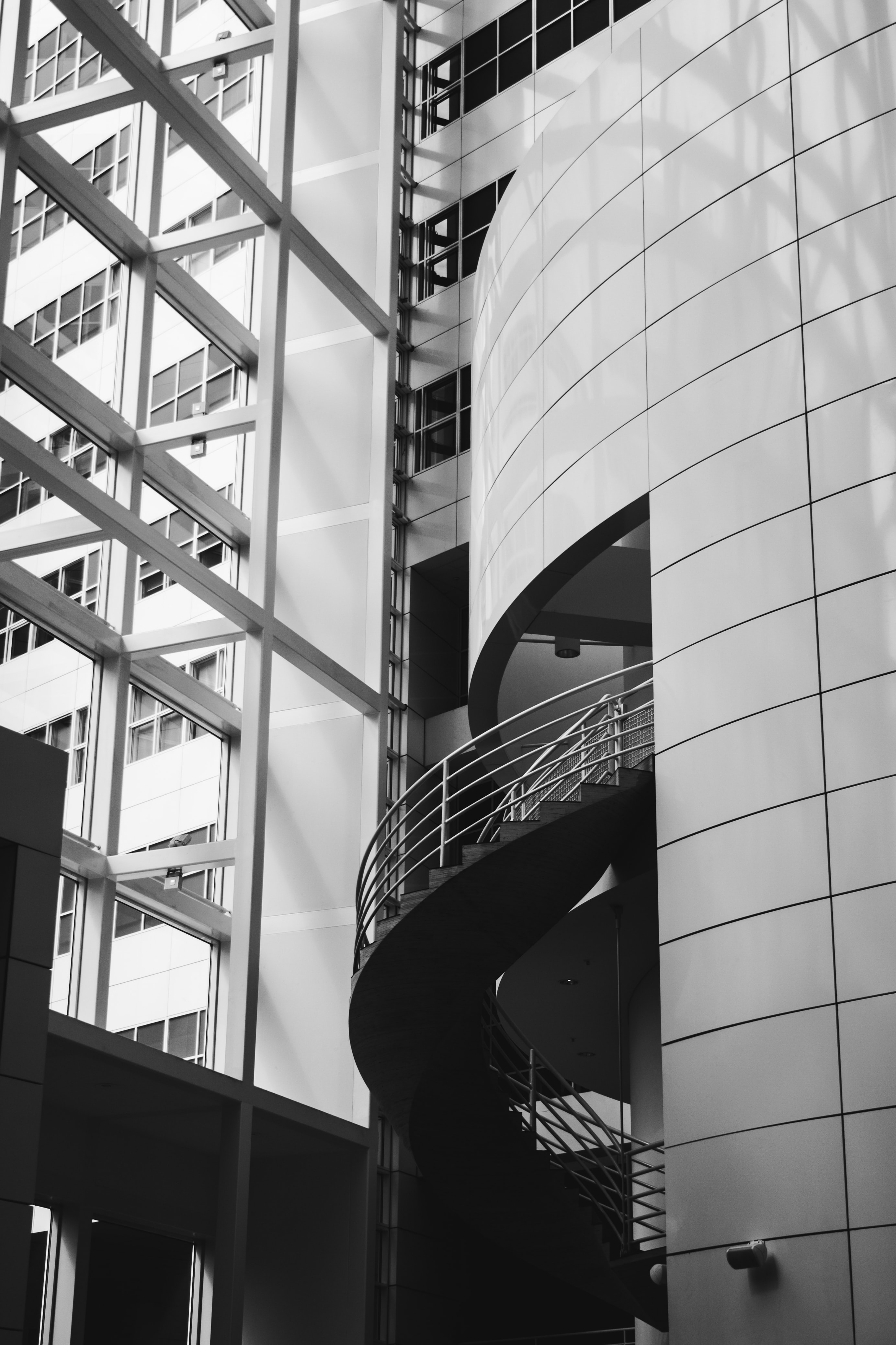 gray spiral stairs of building