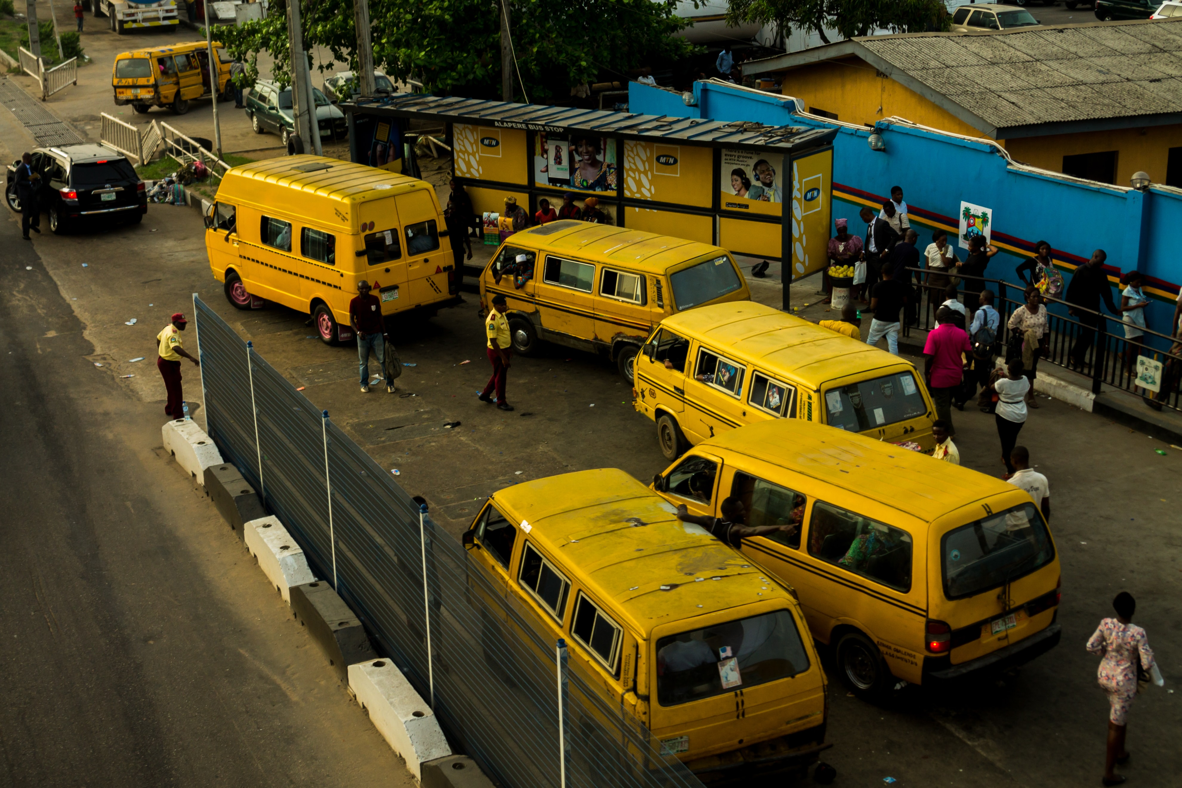 yellow vans on side of road