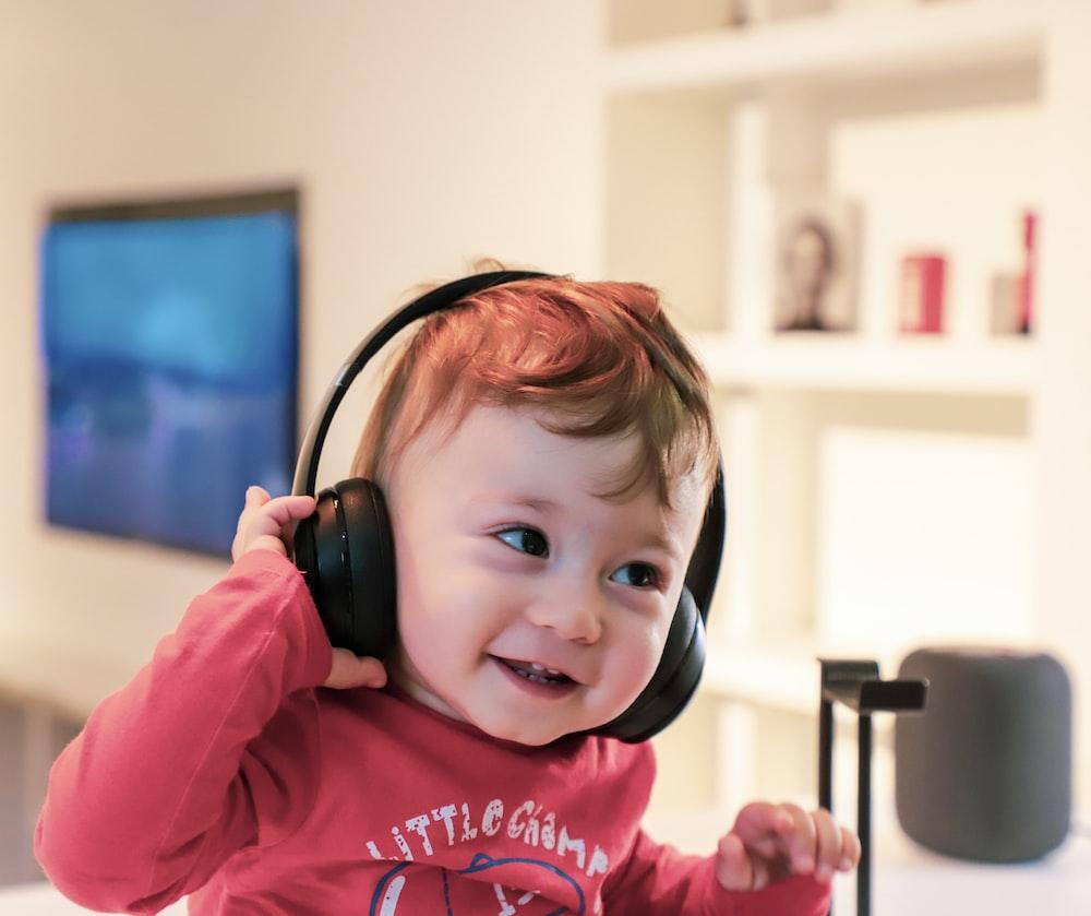 baby listening in black headset