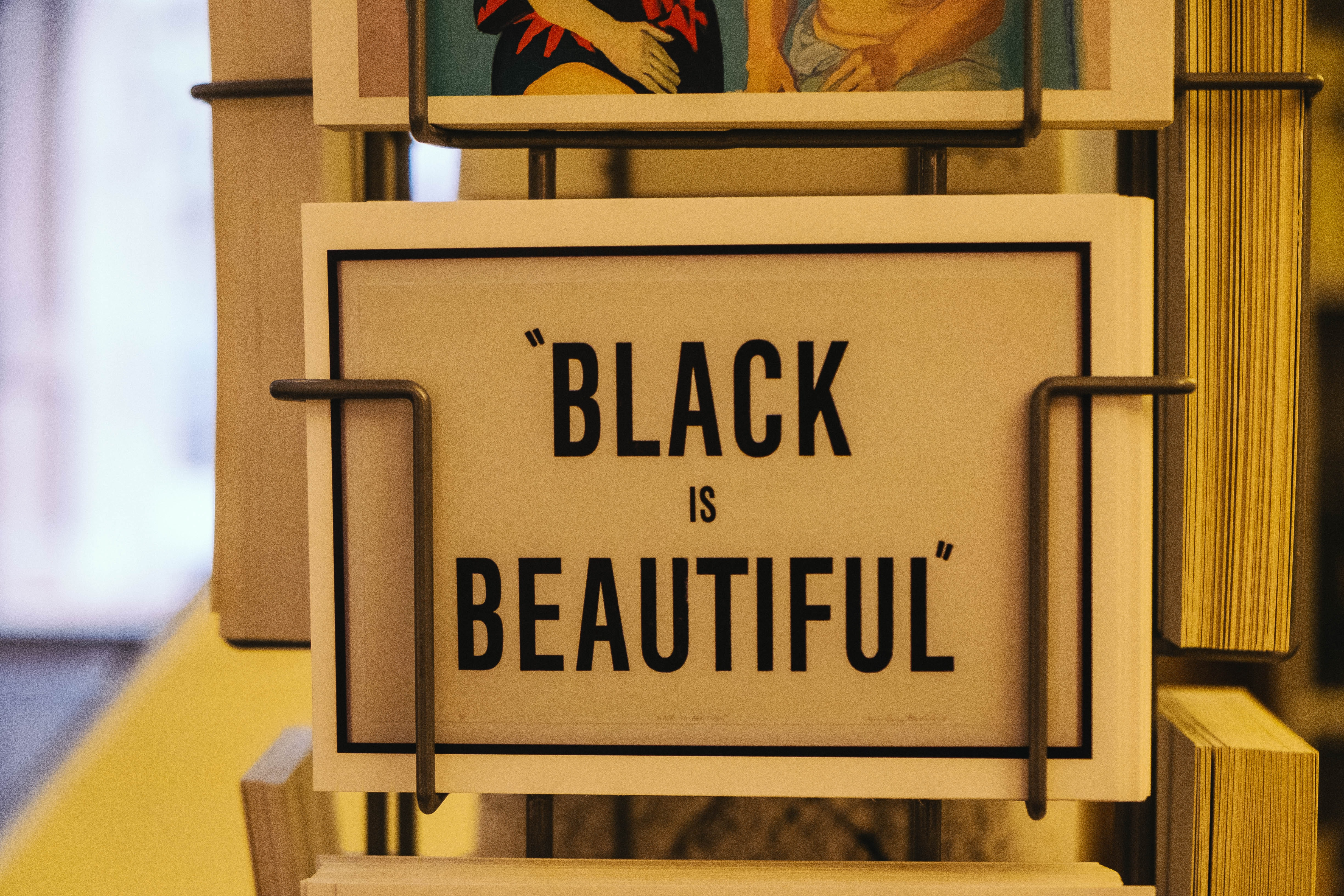 Black is Beautiful card on rack