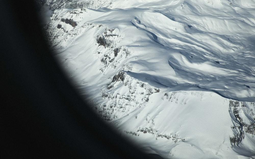 aerial photo of snow covered mountains at daytime