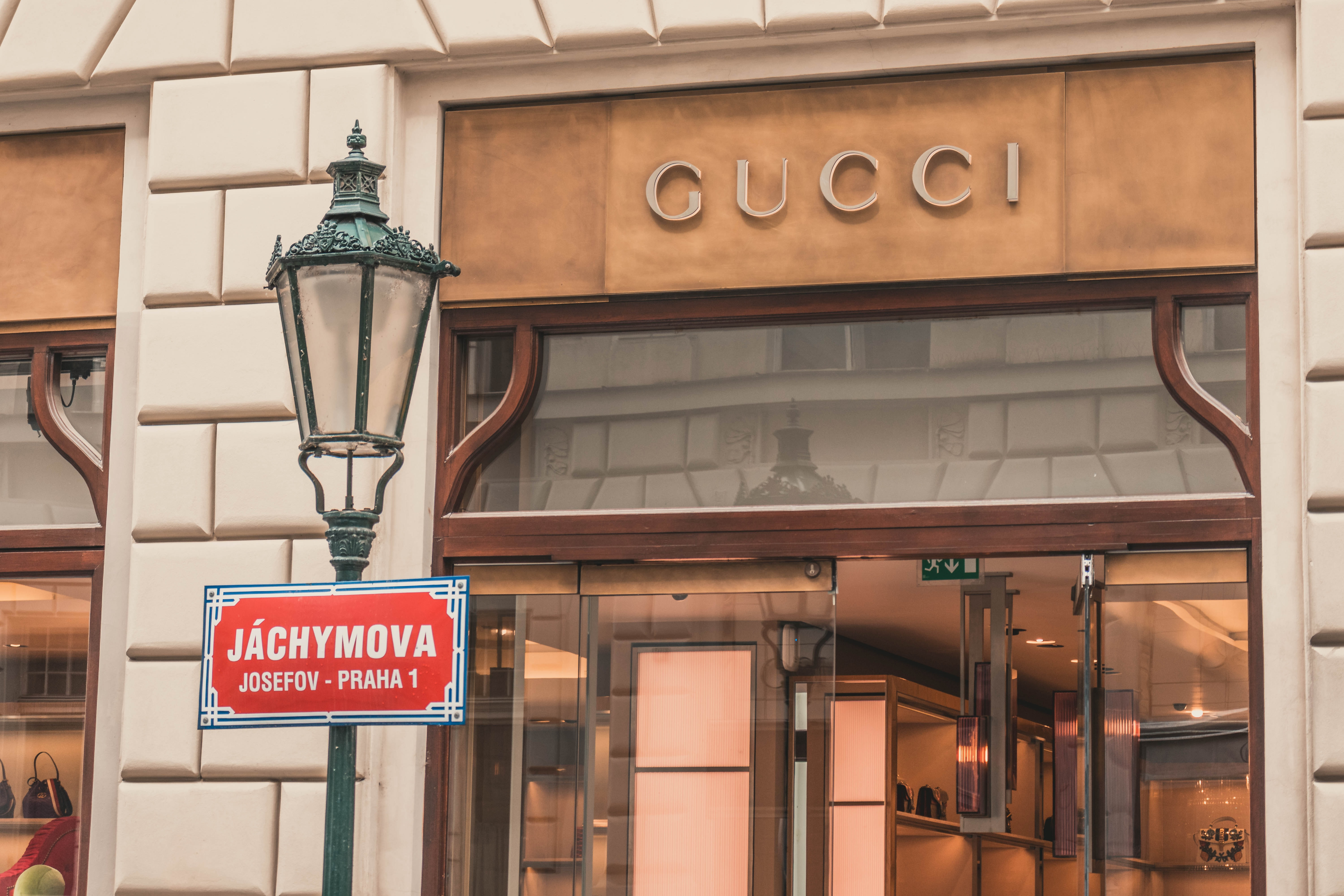 light sconce beside Gucci building signage at daytime