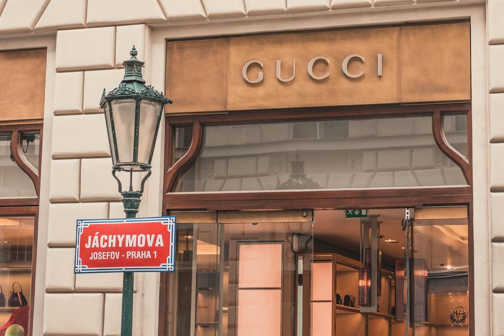 light sconce beside Gucci building signage at daytime