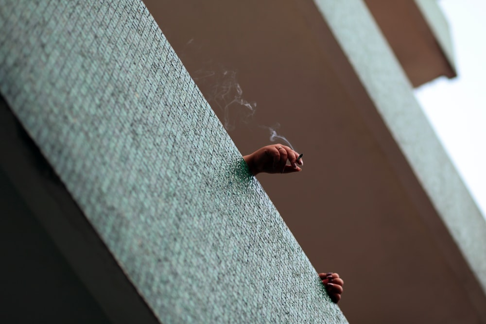 bottom view of person smoking