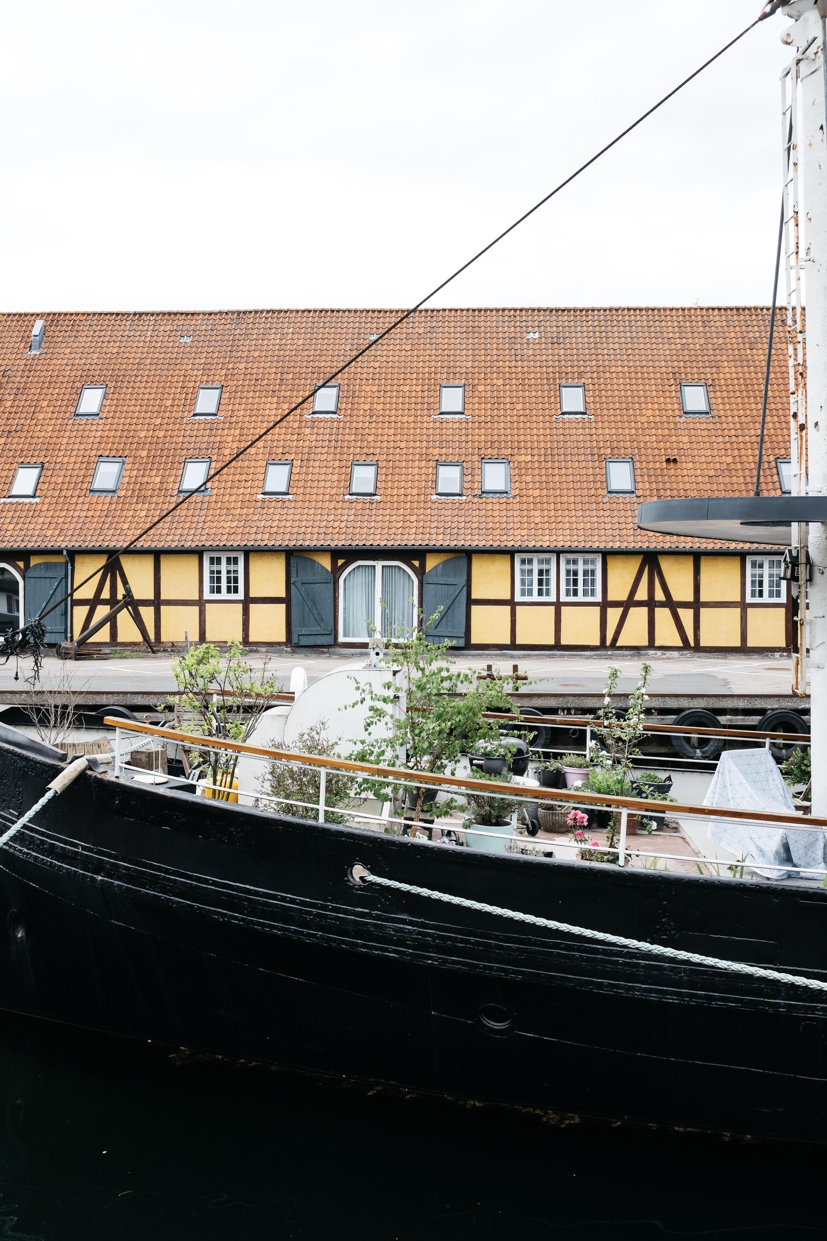 black boat beside the bay