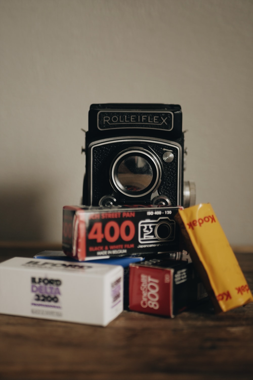 black Rolleiflex camera near boxes