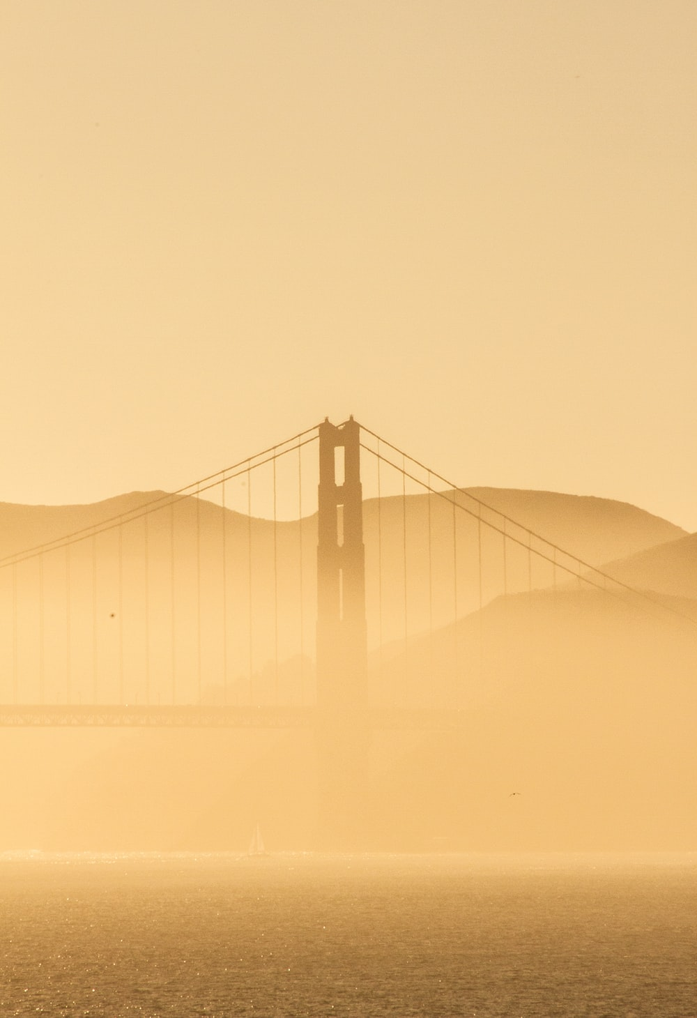 golden gate bridge covered with fog